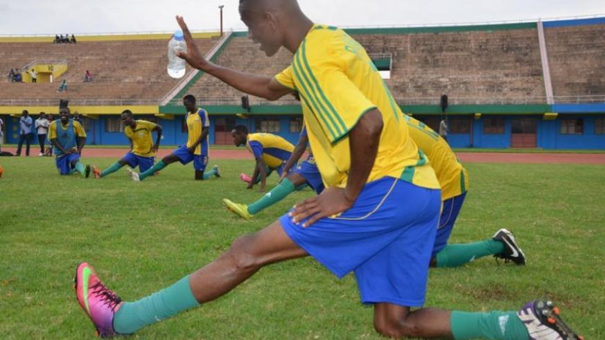 Amavubi players strech during their last training session on friday. The wasps lost to Zambia in a friendly yesterday. (Sam Ngendahimana)