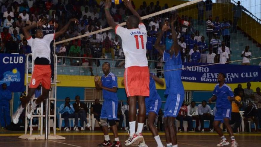 Rayon Sports players prepare to block the ball from Inatek players as both teams clashed on saturday in the national volleyball league. (Sam Ngendihimana)