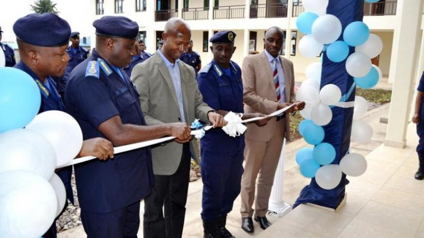 IGP Gasana (2nd L) and Harerimana (2nd right) cut the tape to inaugurate he 'CID School' yesterday. (Courtesy)