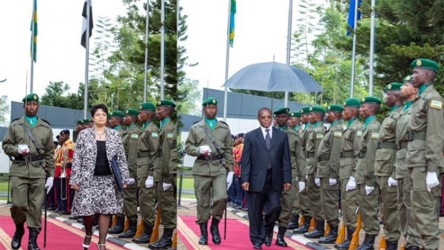 The new Egyptian ambassador to Rwanda, Namira Nabil Mohammed (L), and Ali Idi Siwa, the envoy for Tanzania, inspect a guard of honour mounted by the Presidential Guard at Village Urugwiro in Kigali yesterday. (Village Urugwiro)