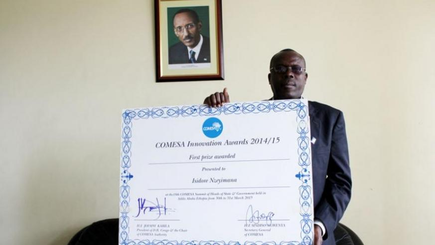 Nzeyimana poses with a dummy certificate he received for his innovation. (Courtesy)