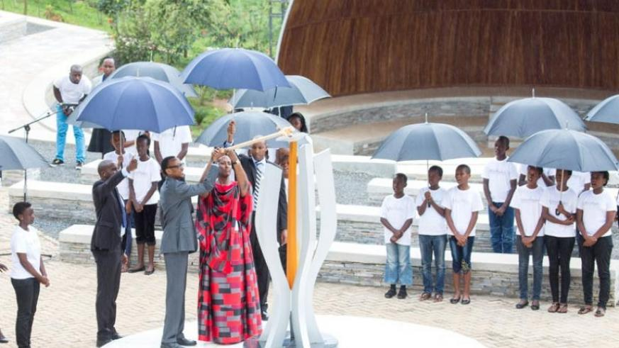 President Kagame and First Lady Jeannette Kagame light the Flame of Hope at Kigali Genocide Memorial Centre, Gisozi, yesterday. (Village Urugwiro)