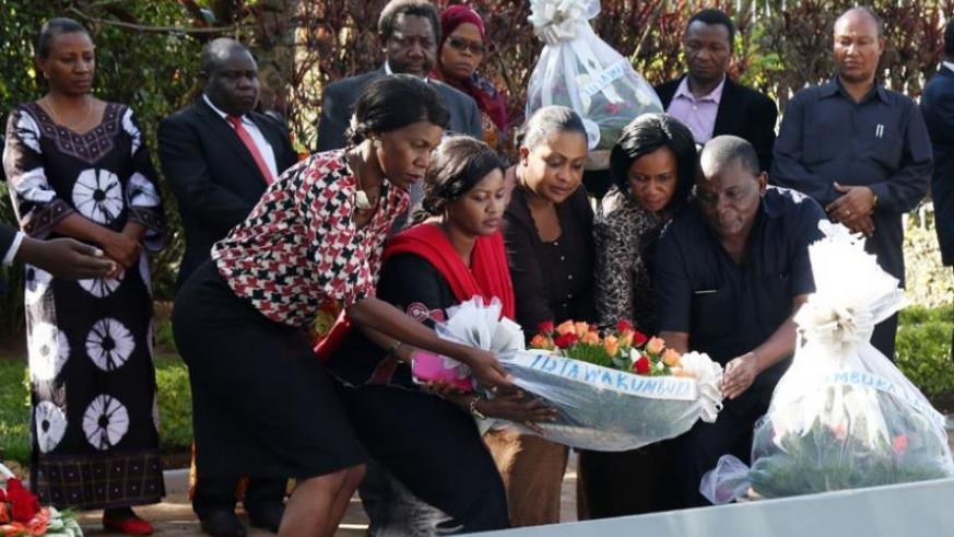 Tanzanian MPs lay a wreath on one of the mass graves at Kigali Genocide Memorial yesterday. (John Mbanda)