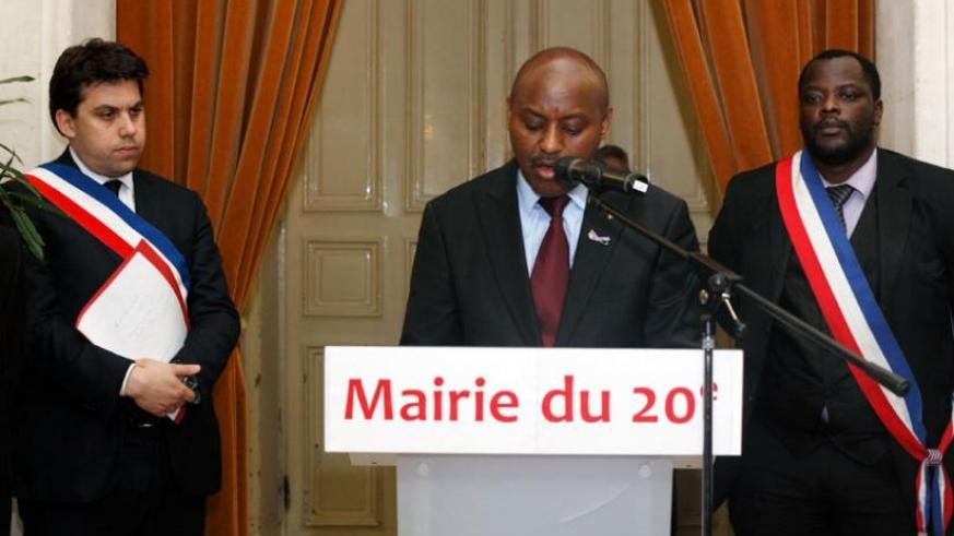 Amb. Kabale (centre) addresses mourners during the commemoration event in France on Tuesday. (Courtesy)