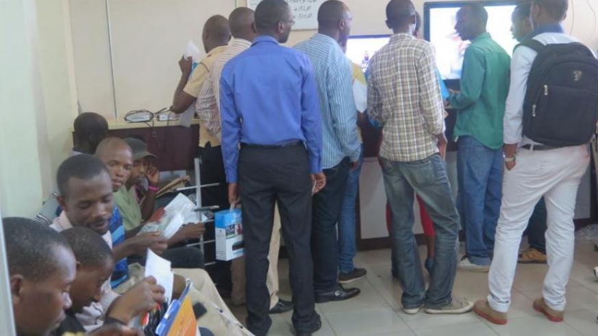 Customers line up to pay subscription charges or buy top set boxes at StarTimes head offices in Kimihurira, Kigali. The pay-TV firm plans to raise monthly subscription fees next month. (Dennis Agaba)