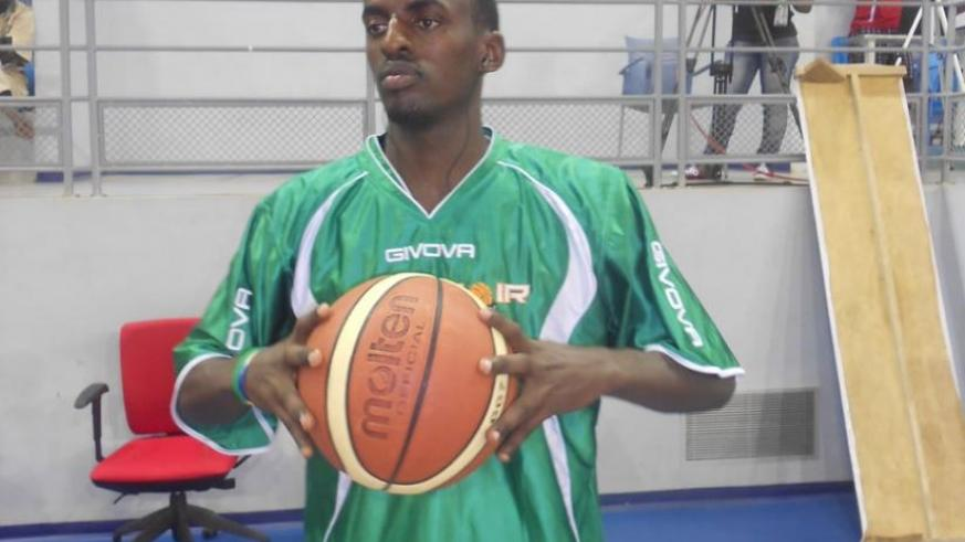Aristide Mugabe prepares to take a shot during a training session. The 27 year old credits basketball for helping him cope with the trauma of genocide. (File)