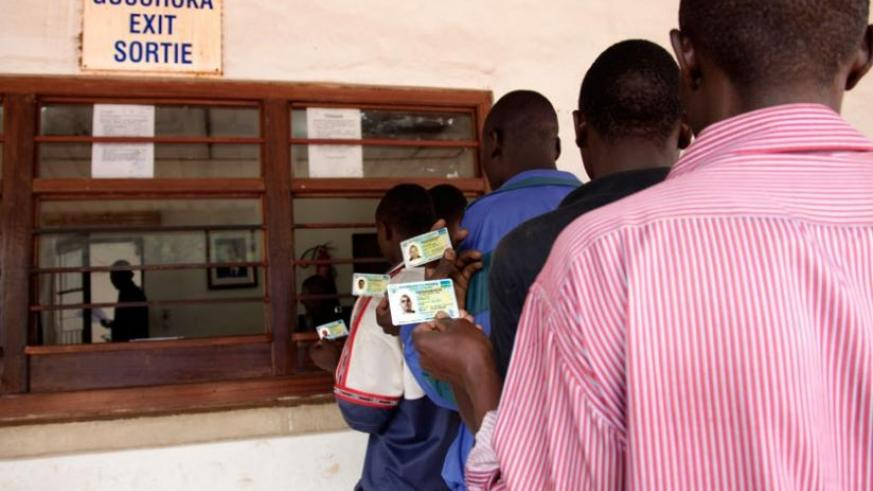 Rwandan nationals travel to Uganda using their identity cards last year. The initiative was introduced to facilitate free movement in the region. (File)