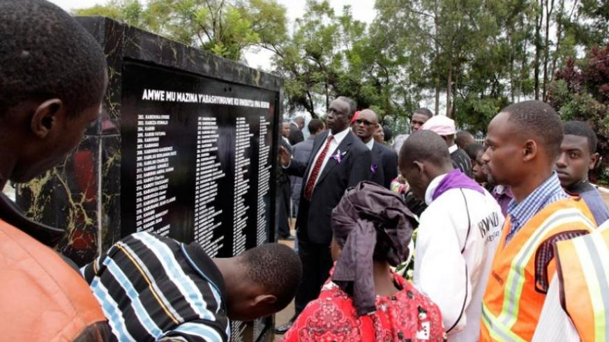 Relatives of the victims of 1994 Genocide peruse through the names at Rebero last year. (File)