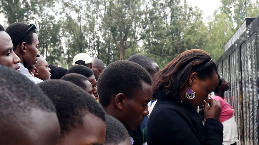 Survivors of the 1994 Genocide against Tutsi are overcome by grief as they read names of the relatives killed in the Genocide at Rebero Genocide Memorial Centre in Kicukiro District on Monday. (John Mbanda)