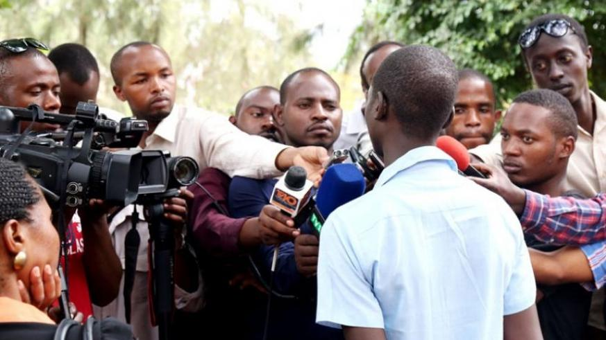 Journalists interview the rescued victim of human trafficking at Police headquarters yesterday. (John Mbanda)