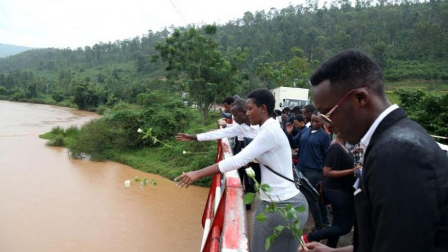 Students from different schools around East Africa commemorate the 1994 Genocide against Tutsi by putting flowers in Nyabarongo river last week. (John Mbanda)