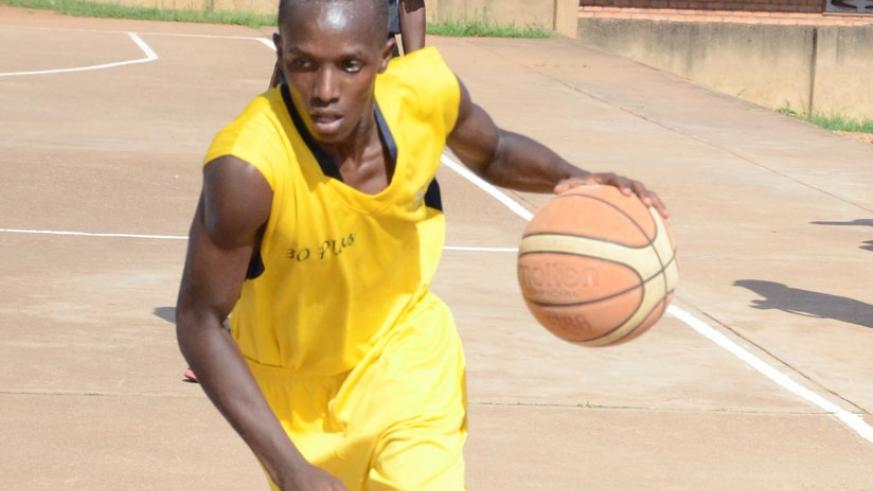 A 30-Plus  Point Guard in action during a previous league game. 30 plus take on IPRC-Kigali at Amahoro indoor stadium. (Sam Ngendahimana)