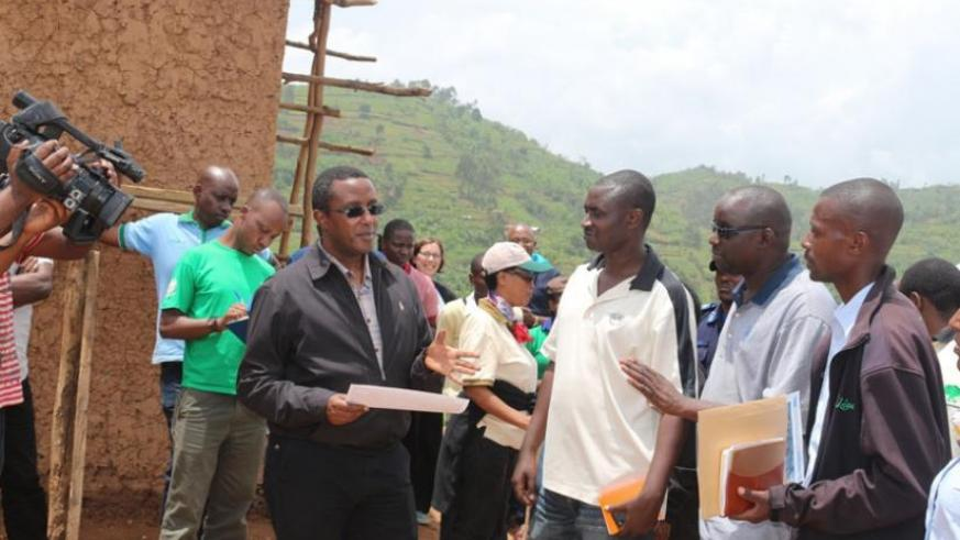 Minister Biruta (right) and other officials at Gashaki site, Musanze district where a model village that will house people living on the islands will be constructed. (Jean d'Amour Mbonyinshuti)