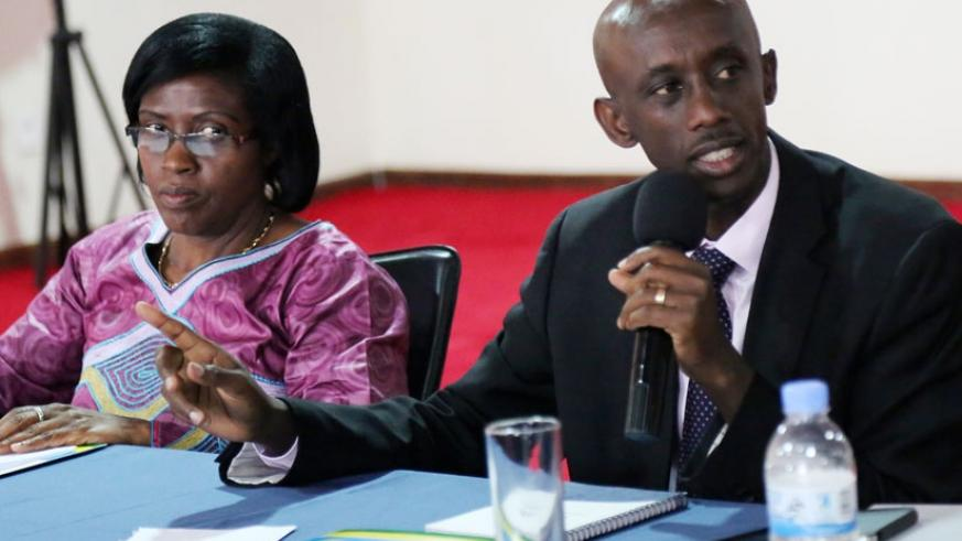 Local Government minister Kaboneka (R) and Deputy Ombudsman Bernadette Kanzayire during the news briefing yesterday. (John Mbanda)