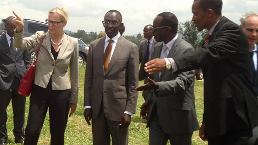 Amb. Cuelenaere (L) and Prof Rugege  (2nd left) are showed to the site of the court premises in Nyanza Distict yesterday. (Courtesy)