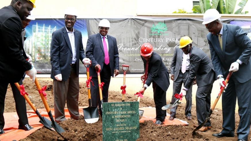 Infrastructure minister James Musoni (right) and other officials at the groundbreaking ceremony for the planned Century Park construction in Kigali yesterday. (John Mbanda)
