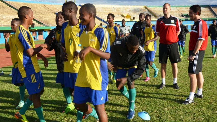 McKinstry (R) oversees his youthful team during his first training session at Amahoro Stadium ahead of the friendly with Zambia, which Rwanda lost 2-0.