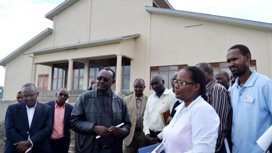 Ministers Mukeshimana (right) and Kanimba (C) and other officials tour the milk processing plant. (Jean d'Amour Mbonyinshuti)
