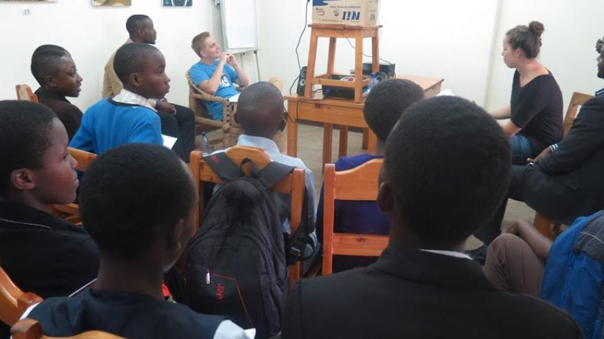 Learners listen to a counterpart from German via video link last week. Rwandan students also had an opportunity to share their views. (Solomon Asaba)