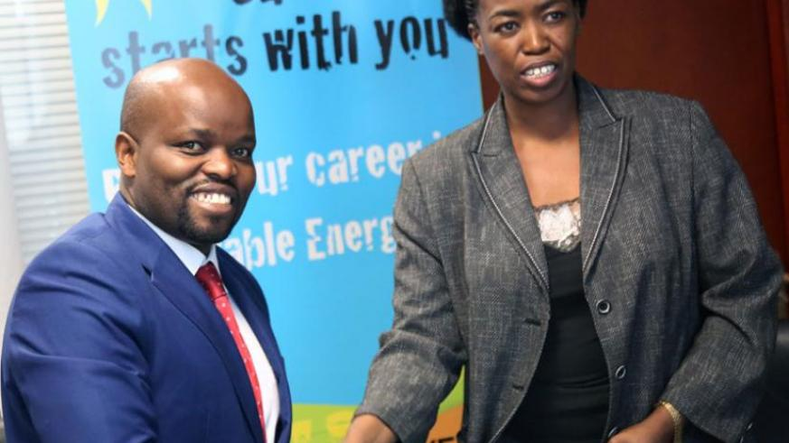 Youth and ICT Minister Jean Philbert Nsengimana (L) shakes hands with SNV Country Director Phomolo Maphosa after signing yesterday. (John Mbanda)