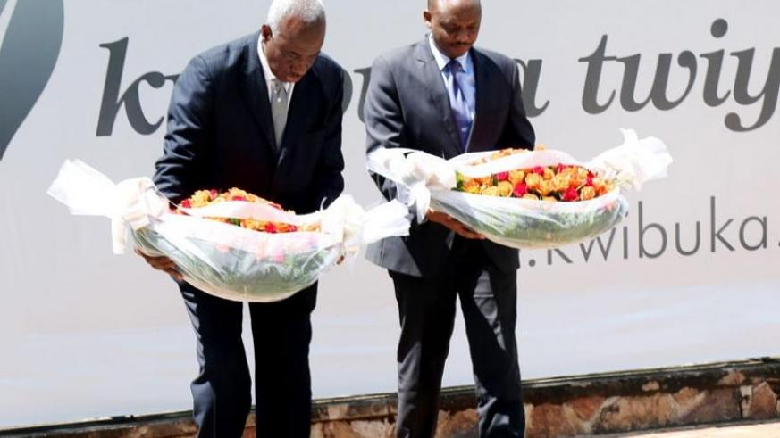 ICTR Chief Prosecutor Hassan Bubacar Jallow (L) and Prosecutor-General Richard Muhumuza pay tribute to Genocide victims at Kigali Genocide Memorial Centre, Gisozi, yesterday. (John Mbanda)