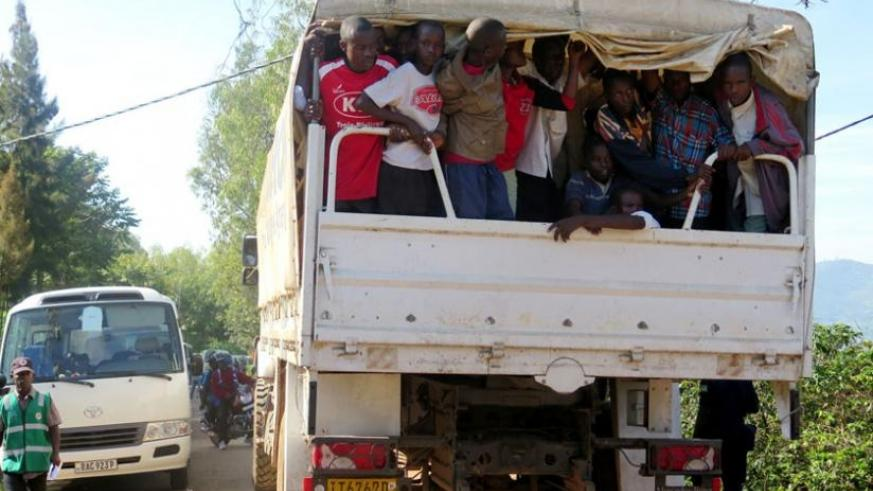 Some of the Burundian refugees are taken to Muyira Sector to register prior to being relocated to Kirehe. (Emmanuel Ntirenganya)