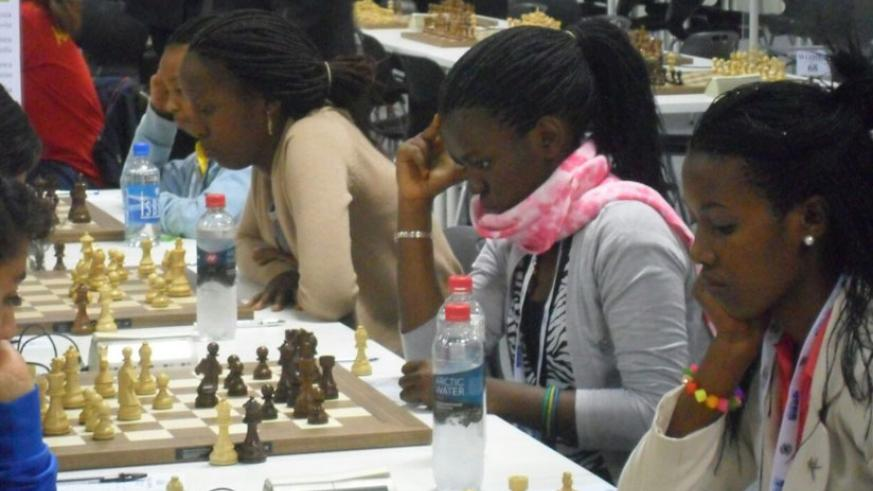 Shimwa (2nd from left) and teammates at the 2014 Chess Olympiad last August. The Rwandan female team at the time included 11-year old Layola Murara Umuhoza (far left). (Courtesy)