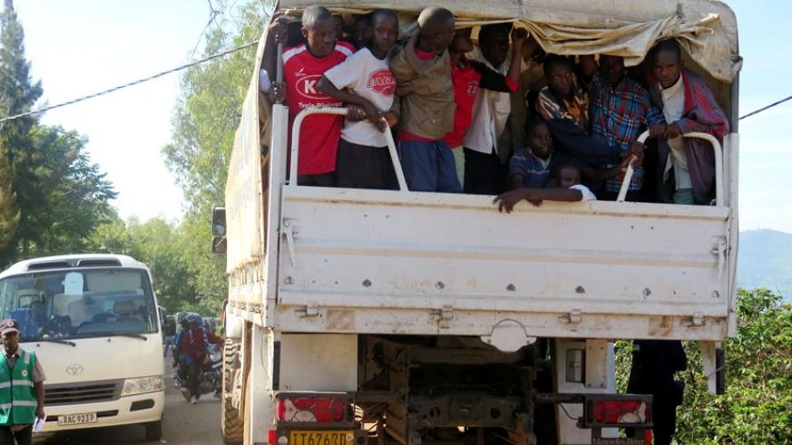 Some Burundian refugees being transported to Muyira Sector to get registered prior to being given proof of registration for asylum seekers, after which they can relocate. (Emmanuel Ntirenganya)
