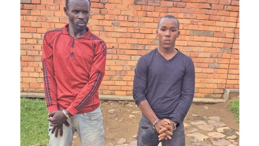 Nshimiyimana (L) and Nshimirimana at Rwanda National Police headquarters in Kacyiru . The duo was arrested on Tuesday. (File)