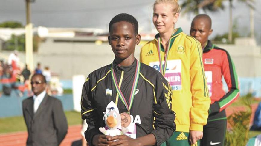 Honorine Iribagiza on the podium with the bronze medal that she won in the 800m. (Courtesy)