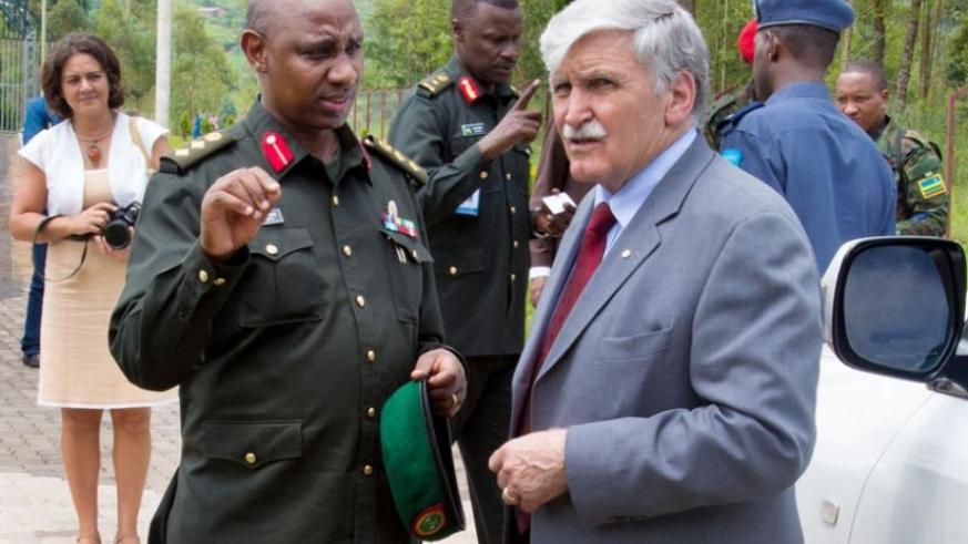 Col Jill Rutaremara, the director of Rwanda Peace Academy, chats with Gen Dallaire yesterday. (Timothy Kisambira)