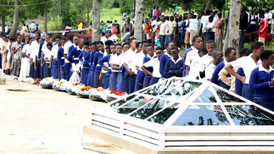 Students queue to enter Ruhango Memorial Site in Kinazi, yesterday, to witness burial of remains of 105 victims of the 1994 Genocide against the Tutsi that were recently retrieved from different parts of the district. (John Mbanda)