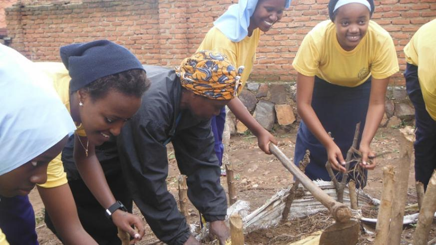 Students establish a vegetable garden for Nzanywayimana recently. (Dennis Agaba)