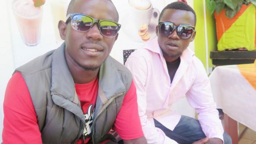 Samuel Niyogakiza (L) and Elie Nsengimana did not let the hardships of living on the street come in the way of their dream to rap. (M. Opobo)