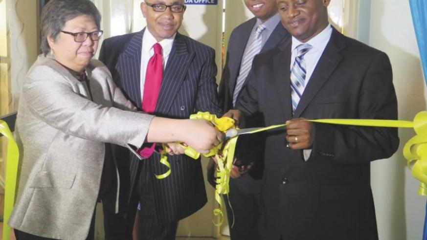 Ledesma (left) and Muhimuzi (right) are joined by other officials at the launch of the firm's new head offices in Kimihurura, Kigali on Tuesday. (Peterson Tumwebaze)