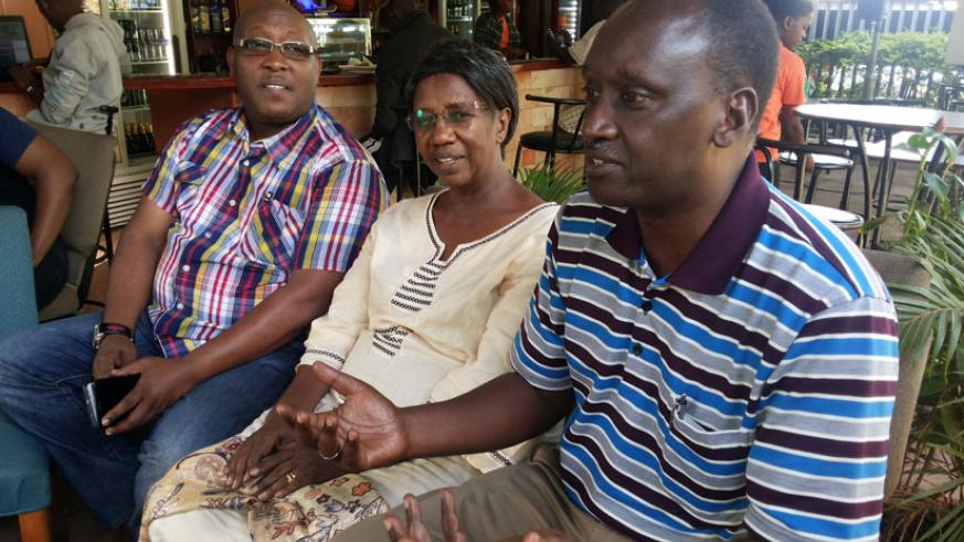 Bishop Birindabagabo (R), Mrs Edith Ariko, the vice chairperson of the fundraising team (C) and Isaac Rucibigango at the final preparatory meeting yesterday.