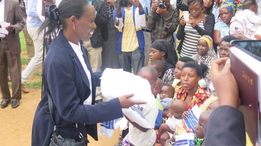 Dr Corine Karema, the head of malaria and other parasitic diseases at Rwanda Biomedical Centre, distributes bed nets in Gashora, Bugesera District. (File)