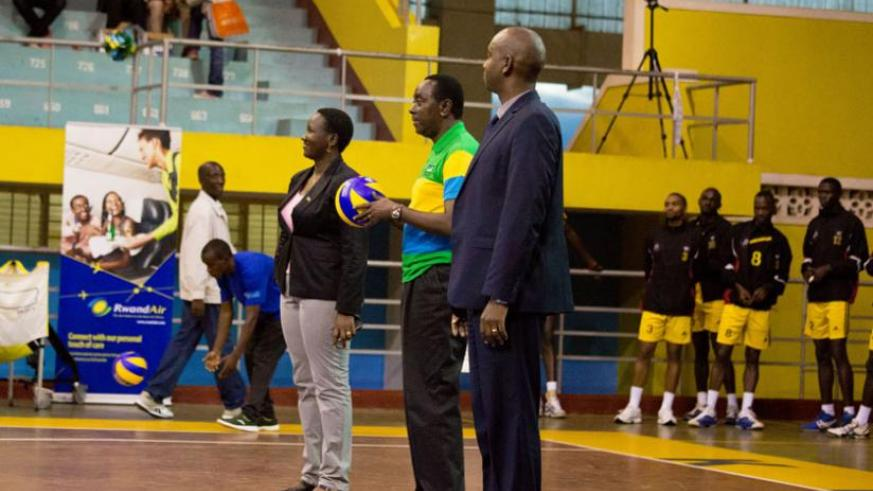 Senate President Bernard Makuza prepares to strike the Ball to officially open the ceremony. On his left is Sports Minister Julienne Uwacu while the Volleyball Federation Chairman Gustave Nkurunziza is on the right.