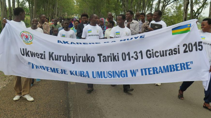 Youth march during the launch of the YouthConnekt in Kinazi Sector, Huye District on Saturday. (Emmanuel Ntirenganya)