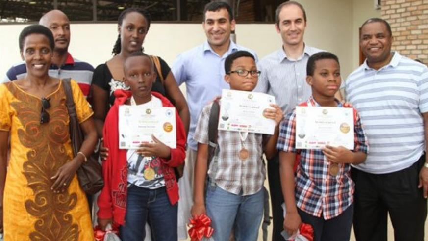 Winners (front row) show off their certificates. (Courtesy)
