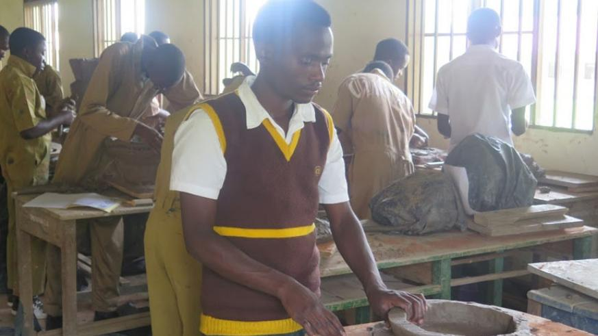 A student moulds an object from clay. The partnership will boost vocational education. (Solomon Asaba)