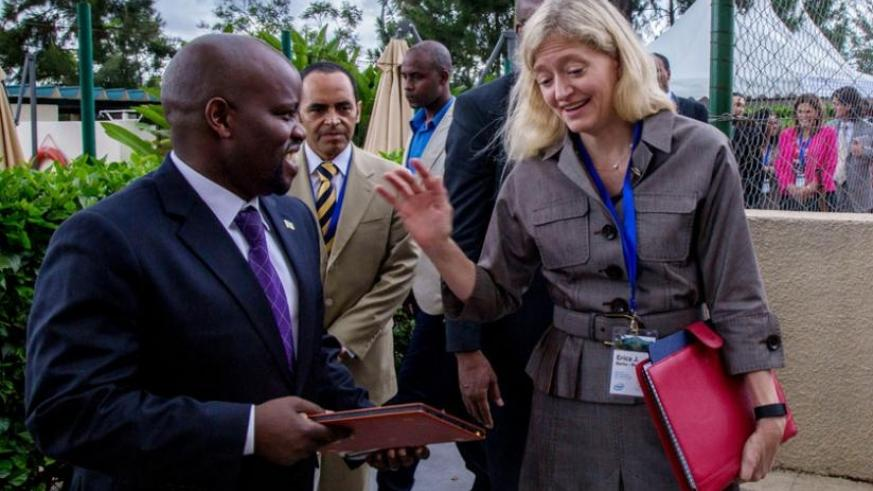 Minister Nsengimana (L) chats with the US Ambassador to Rwanda , Erica Barks-Ruggles, at the launch of the forum in Kigali yesterday. (Timothy Kisambira)
