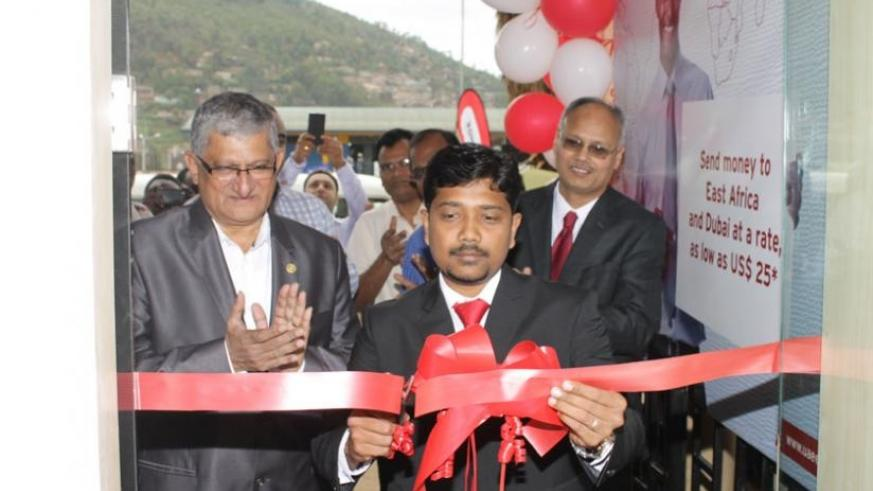 Riyaz Naghoor, the firm's Head of operations cutting the ribbon.The new branch is expected to bring on board efficiency. (Courtesy)