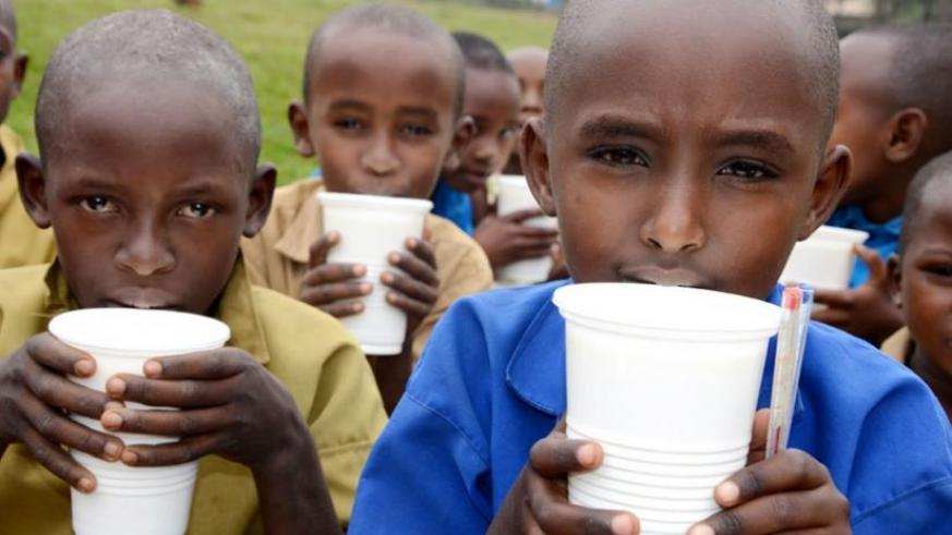 Pupils enjoy milk at school. Schools offering 12YBE have urged government to fast-track feeding support. (File)
