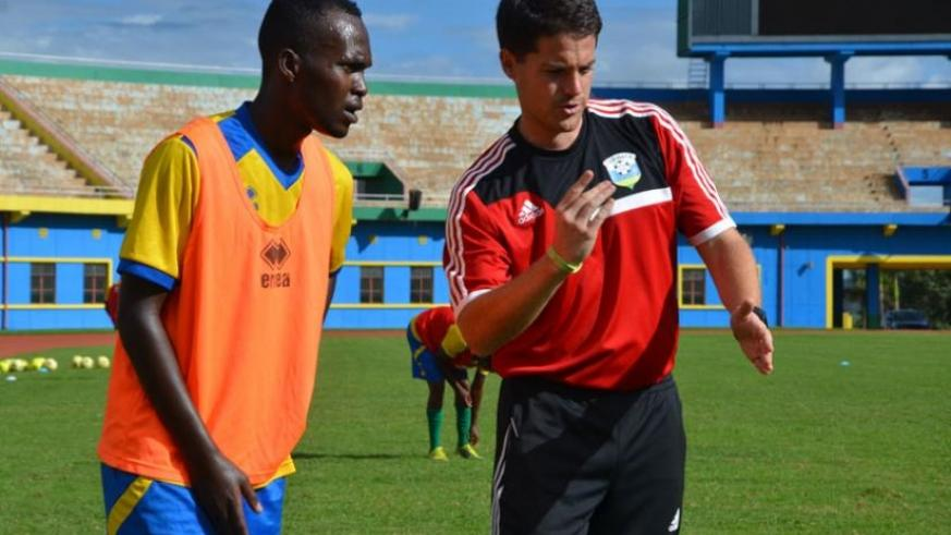 Amavubi coach Johnny McKinstry gives AS Kigali defender Janvier Mutijima instructions during training recently. Amavubi need just a draw to qualify for the next round. (Sam Ngendahimana)