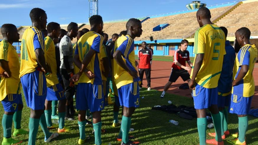 Amavubi players listen to coach Johnny Mckinstry during a training session. Better performances from the national side will see Rwanda improve further in Fifa rankings. (Sam Ngendahimana)