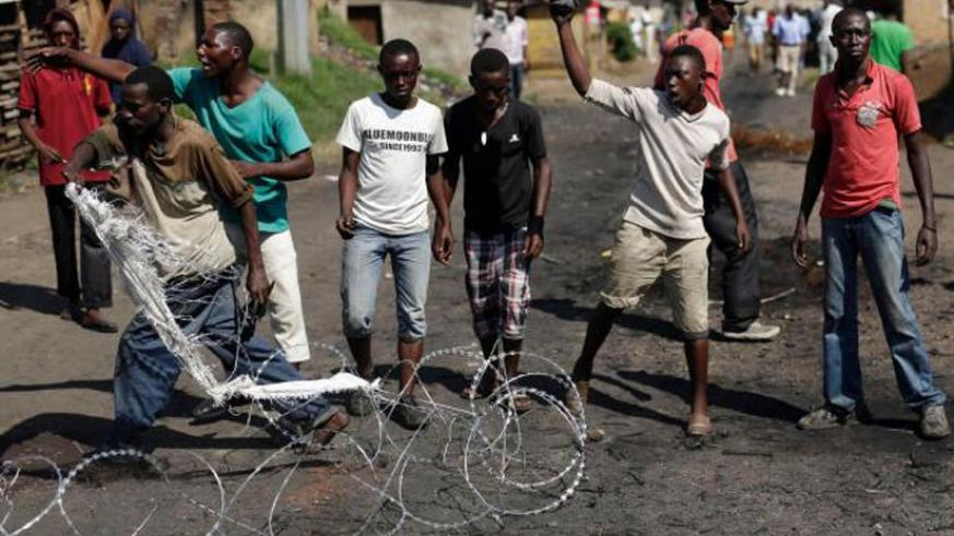 Demonstrators shout at army and police officers in the Musaga district of Bujumbura, yesterday.