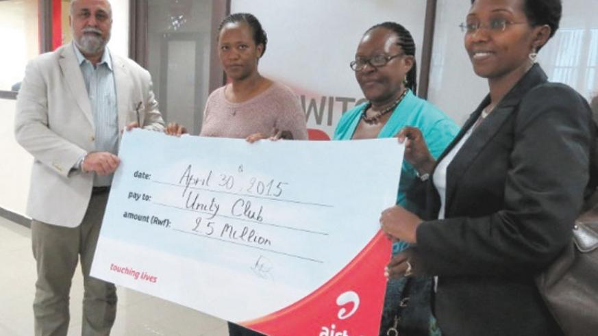 (L-R) Mr. Bhullar hands over the cheque to Ms. Eutochie Sezibera, Ms. Iyamuremye and Ms. Coletha Ruhamya from Unity Club. (Courtesy)