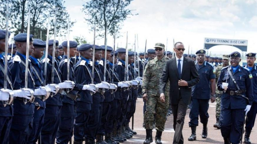 President Kagame inspects a parade of Police Cadet Officers at their pass-out ceremony at Police Training School in Gishari, Rwamagana District yesterday.(Village Urugwiro)