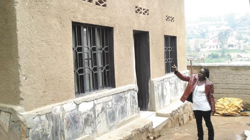 Mukahirwa points at one of her houses which she rents out in Gishushu. (Peterson Tumwebaze)